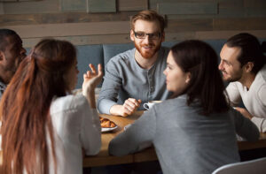 People living with epilepsy meeting up for a coffee and having a chat.