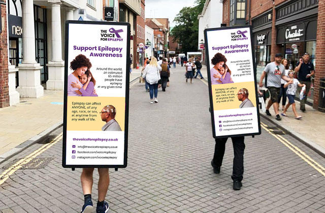 The Voice For Epilepsy charity advertising with adwalkers handing out leaflets