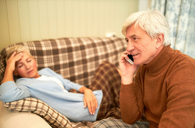 Living with Epilepsy - image of husband calling 999 for his wife affected by epilepsy